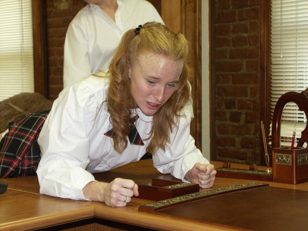 Paddled in her school uniform