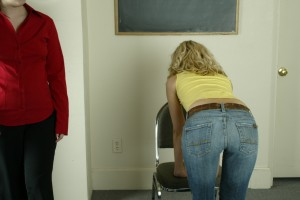 Bent over waiting to be paddled at school