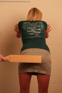 bent over and paddled at school