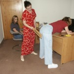 High school girls receiving a paddling.  Real school corporal punishment.