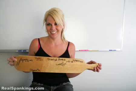 Showing her signature on the paddle.